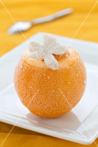 A frozen orange with a flower