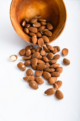 Almonds in and next to a bowl