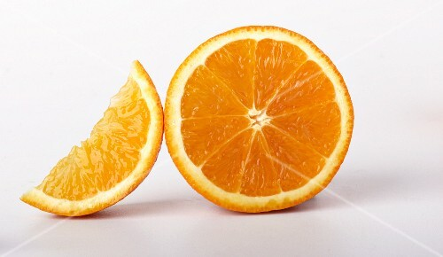 A wedge of orange and an orange slice