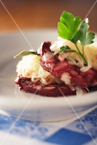 Black pudding with sauerkraut and parsley (close-up)