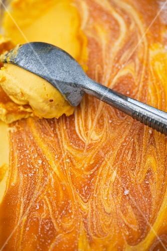 mango ice cream with a ice cream scoop