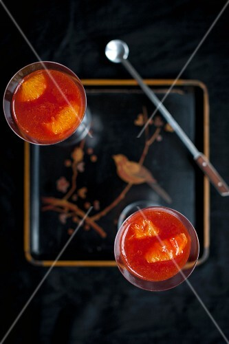 Orange and Campari jelly in a glass glass on the tray