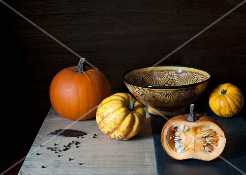 pumpkins on the table with the bowl