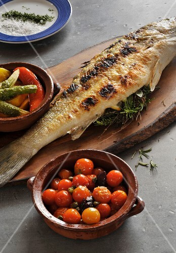 Baked fish with herb filling and pickled vegetables