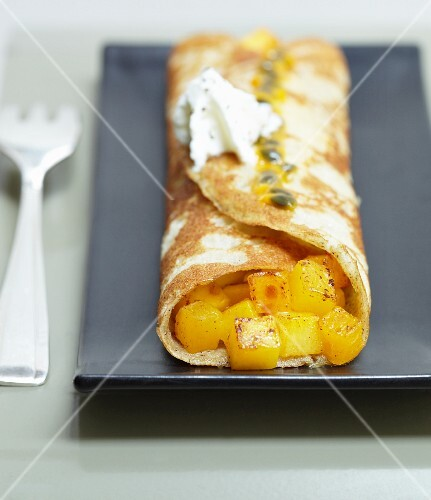 A pancake filled with diced mango