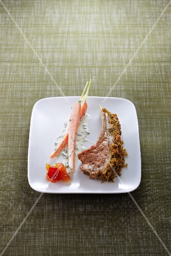 Lamb chop with a herb crust and carrots