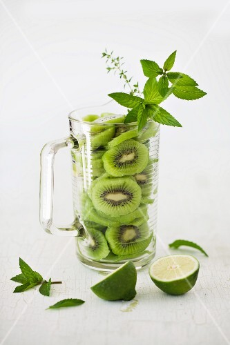 Sliced Kiwi with Mint and Lime in a Pitcher
