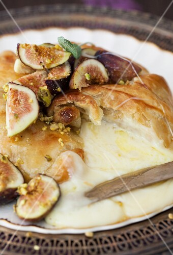 Pastry Wrapped Baked Brie with Figs and Honey; Sliced