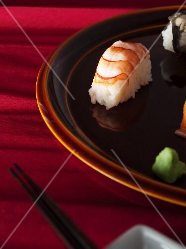 Nigiri sushi (prawn, salmon) and wasabi