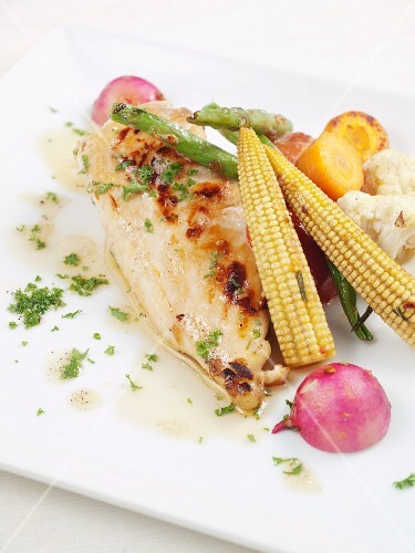 Grilled chicken breast with butter sauce and baby sweetcorn