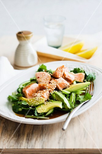 Grilled salmon on an avocado & cucumber salad
