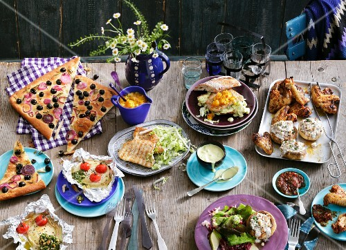 Assorted barbecued dishes with sauces and focaccia