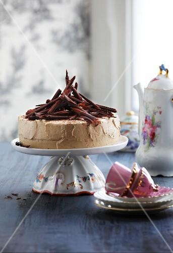 Mocha layer cake with chocolate curls
