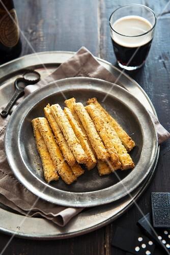 Sesame breadsticks and beer