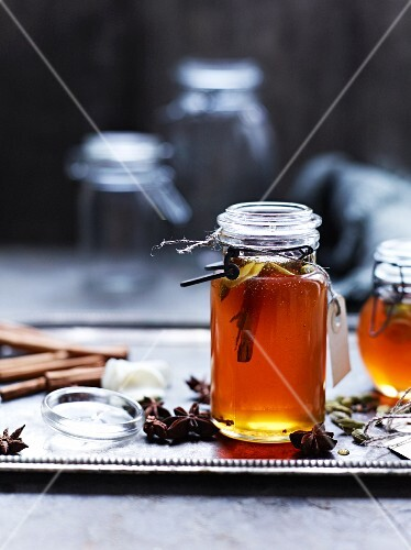 A jar of honey with spices