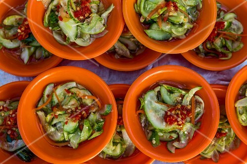 Spicy sauce with vinegar, cucumber, carrots and chilli in small bowls (Cambodia)