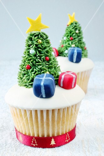 Christmassy cupcakes decorated with presents and Christmas trees