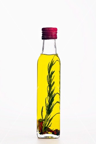 Flavoured olive oil in a bottle with rosemary and chilli