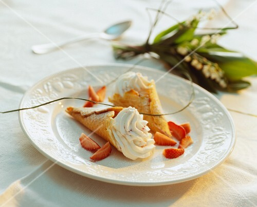 Wafer cones with strawberries and cream