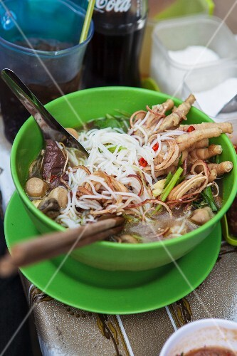 Fermented rice noodle soup with black pudding and chicken feet (Phnom Penh, Cambodia)
