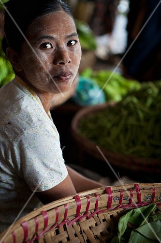 A seller at a market in Myanmar