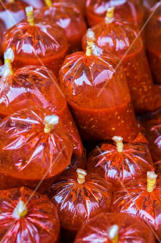 Chilli sauce in plastic bags at a market in Cambodia