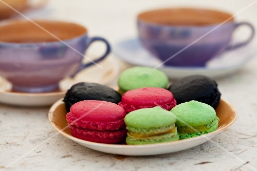 Colourful macaroons on a side plate