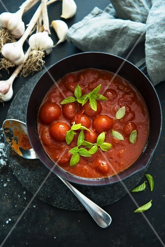 Tomato sauce with whole cherry tomatoes (view from above)