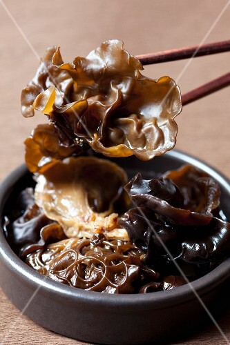 Jelly ear fungus in a bowl and on chopsticks