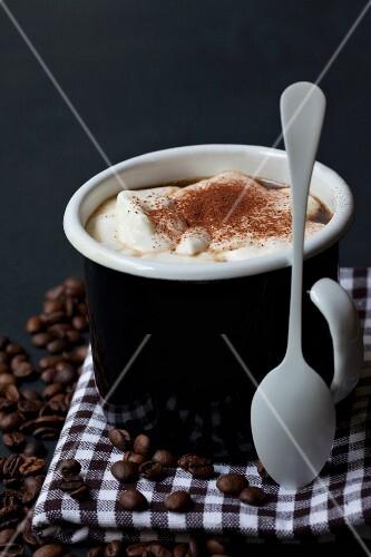 A cappuccino with cream in a mug