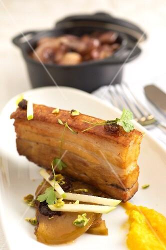 Fried pork belly with sautéed shallots