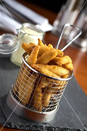 Deep-fried breaded sprats in a deep-frying basket