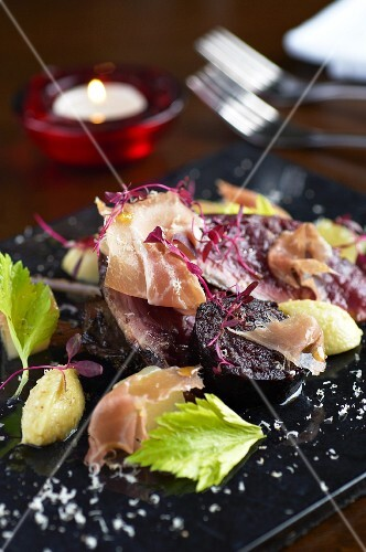 Hazel grouse with dry-cured ham and cheese (England)