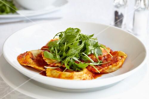 Ravioli with tomato sauce and rocket