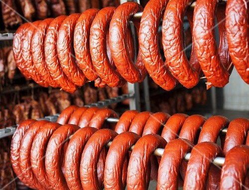 Sausages hanging in a smokehouse
