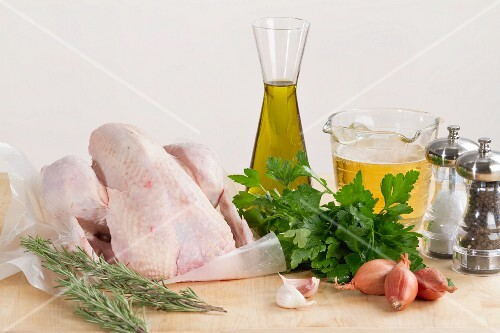 A fresh chicken, rosemary, parsley, olive oil, beer, shallots, salt and pepper