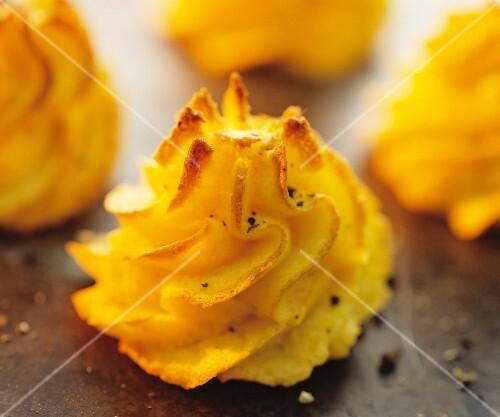Duchesse potatoes (baked rosettes of mashed potato)