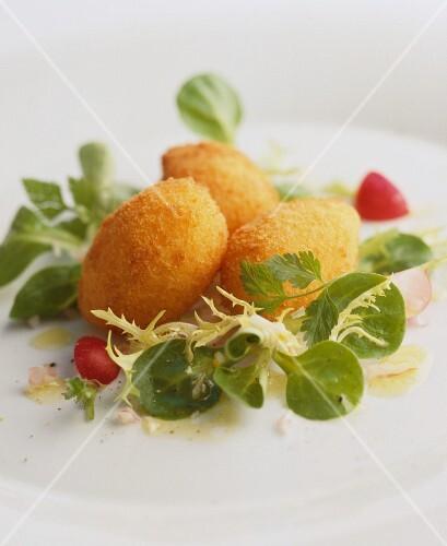 Deep-fried rice balls on salad leaves
