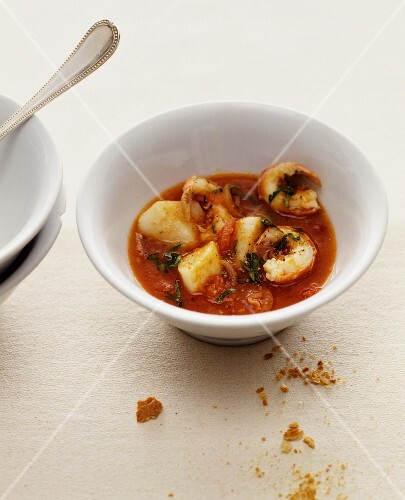 Tomato soup with fish and prawns