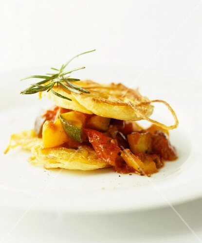 A stack of fried potato slices and ratatouille