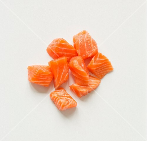 Cubed Raw Salmon on a White Background