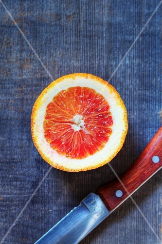Half of a Blood Orange with a Knife
