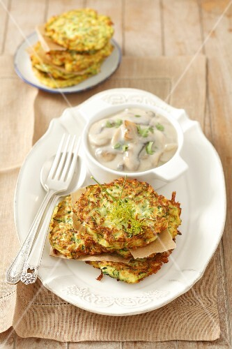 Courgette fritters with mushroom sauce