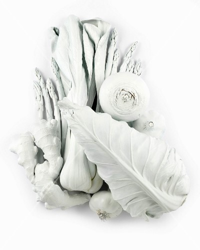 A still life in white, featuring vegetables