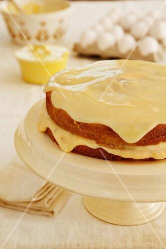 Boston Cream Pie, sponge cake with a vanilla cream filling and a white chocolate glaze