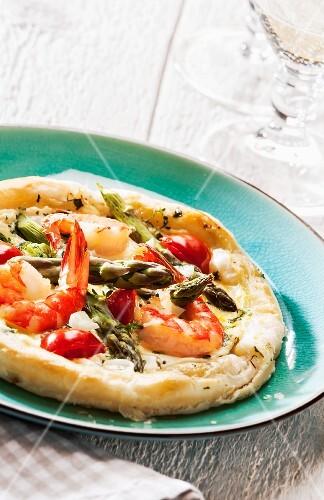 A prawn tart with green asparagus