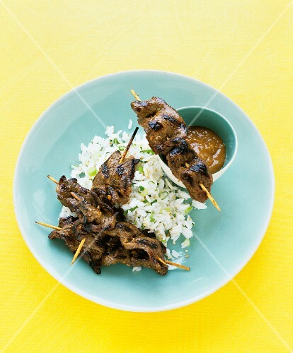 Beef skewers with peanut dipping sauce and sesame rice