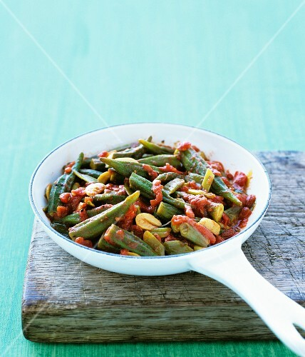 A dish of okra and tomatoes in a pan