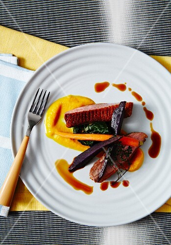 Duck breast with carrot purée, spinach and roasted carrots