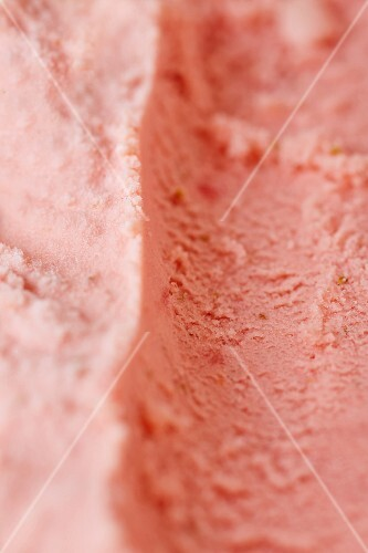 Track left by an ice cream scoop in fresh home-made strawberry ice cream